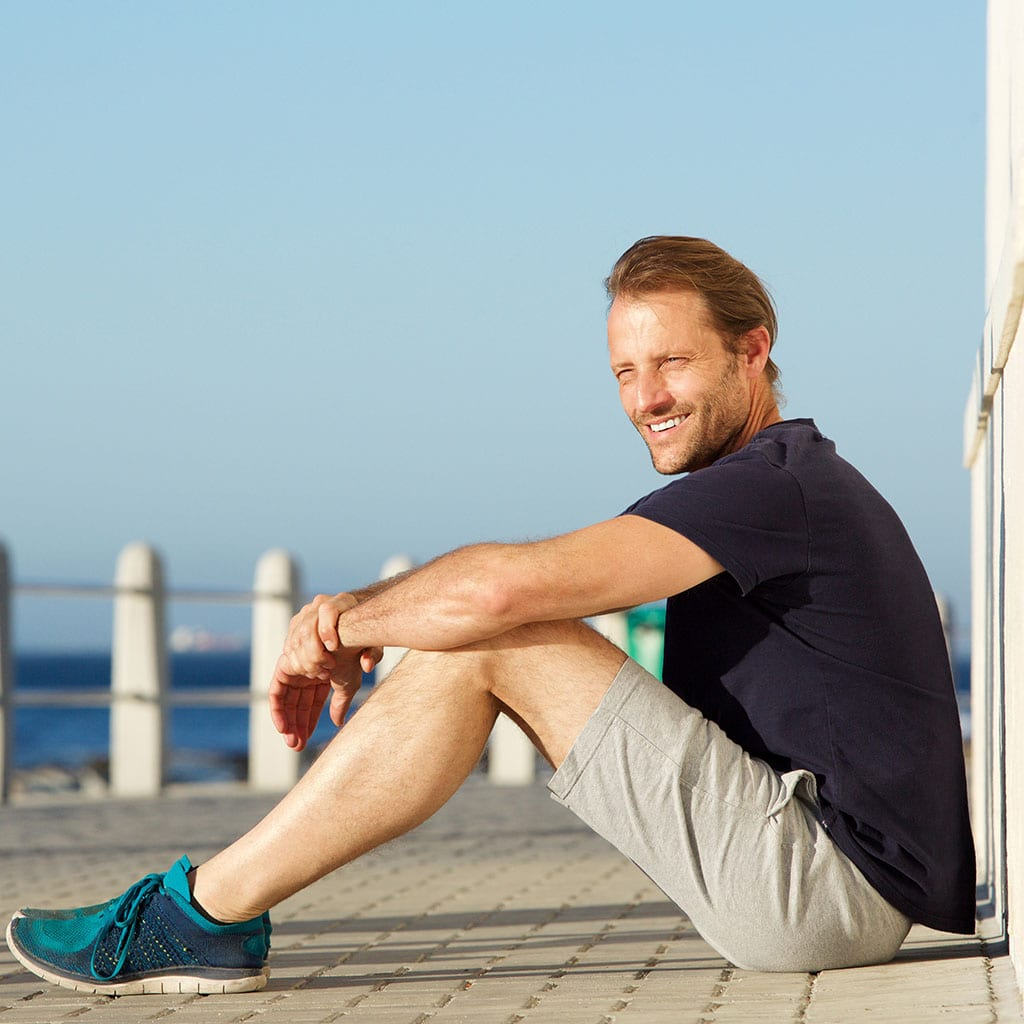 active middle age man sitting outside and smiling